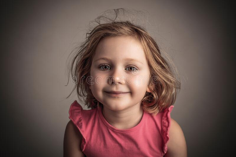 Studio portrait of a 4 year old girl royalty free stock photography