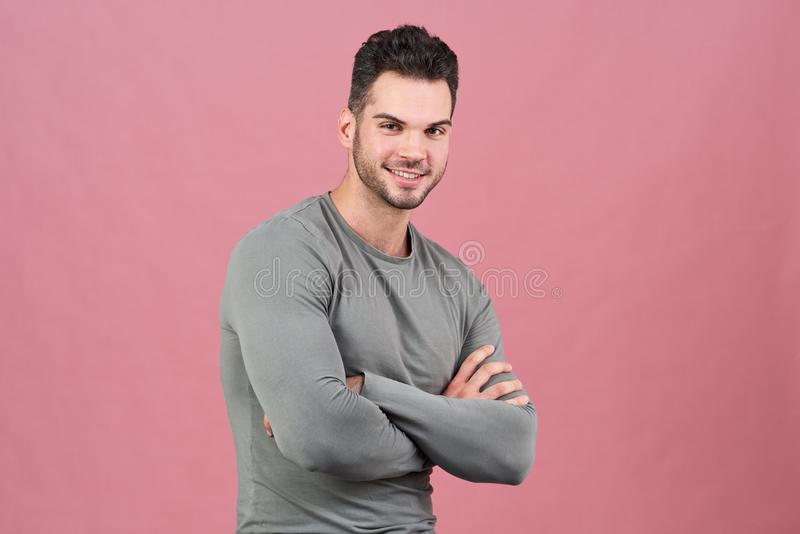 Studio portrait of a young athletic guy with his hands on his chest and a friendly smile. stock image