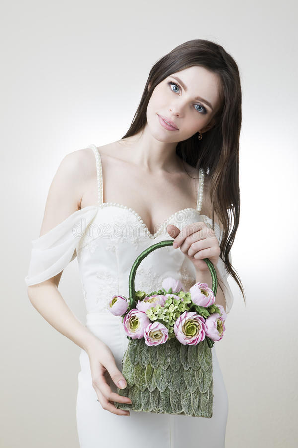Studio portrait of a young beautiful bride with her handbag in her hand stock images
