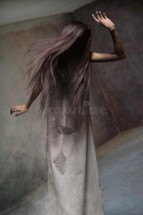 Studio portrait of young faceless lady stock photos
