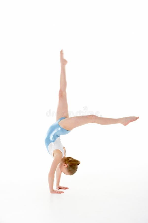 Studio Portrait Of Young Female Gymnast stock photography