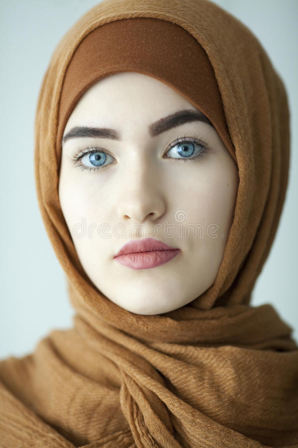 Studio portrait of a young girl with a European face in eastern clothes on a white background royalty free stock image
