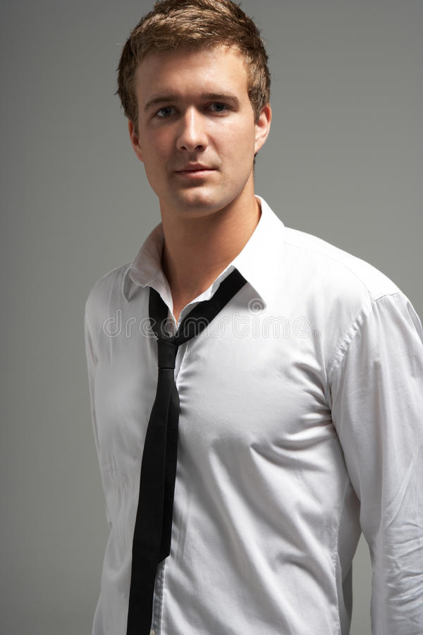 Studio Portrait Of Young Man Wearing Shirt And Tie royalty free stock photos