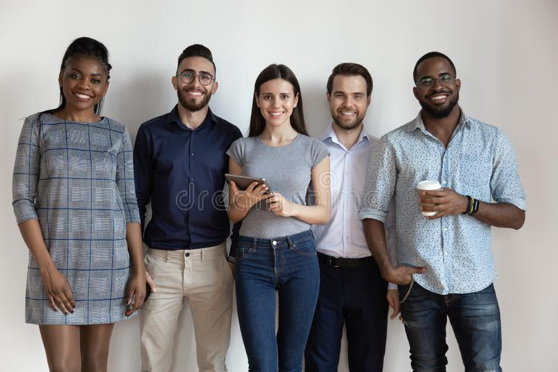 Studio portrait young successful diverse business people team. stock photo