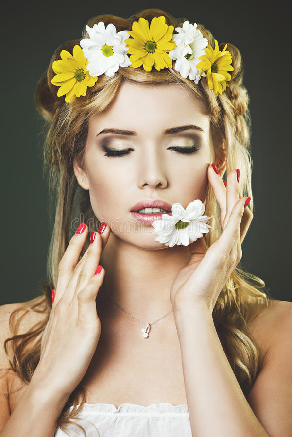 Studio portrait of young woman with the floral wreath royalty free stock photo