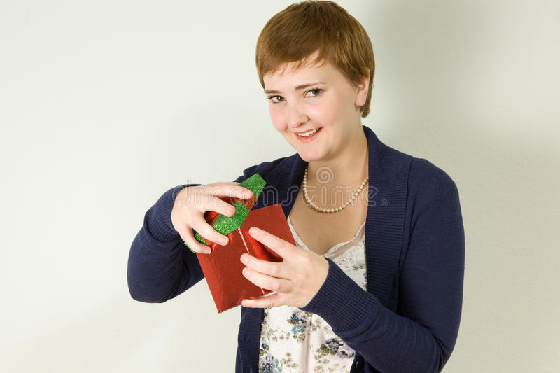 Download Studio Portrait Of Young Woman Holding Gift Box Stock Image - Image: 23077445