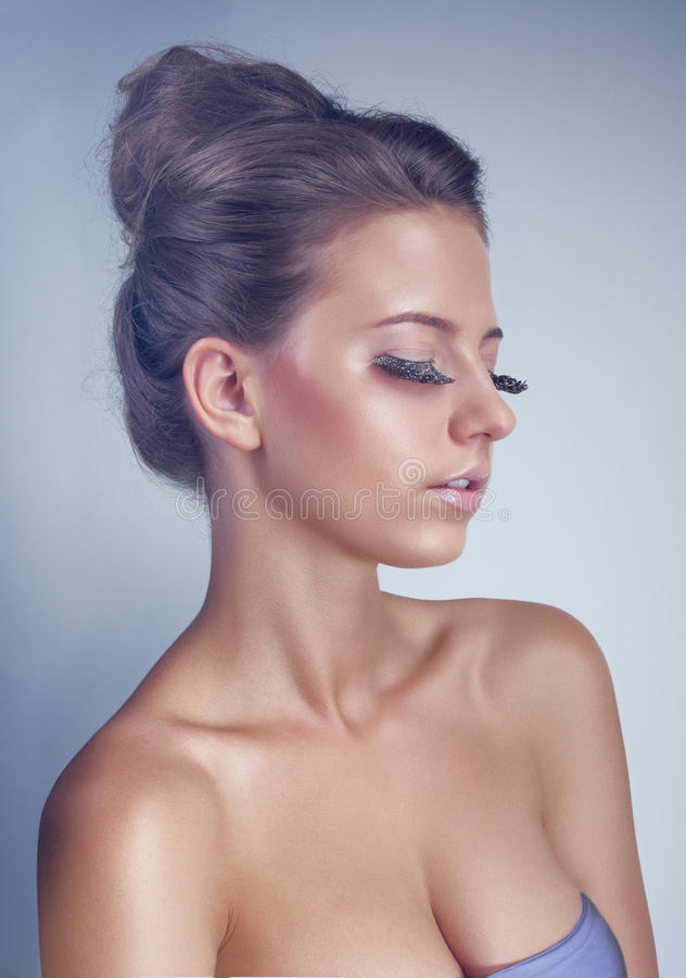 Studio portrait of young woman with long eyelashes royalty free stock photo