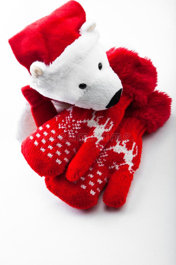 Baby winter clothes wool red mittens white background. Studio quality white background red wool mittens baby winter clothes bear Santa Claus Christmas gift stock photography
