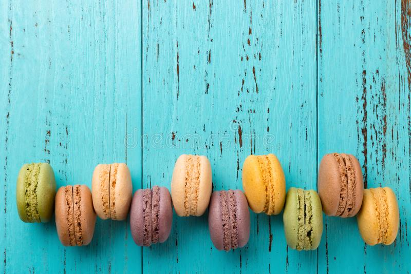 Studio shoot of colorful macaroons line up on blue background with copy space. Studio shoot of colorful macaroons line up on a blue background with copy space royalty free stock photos