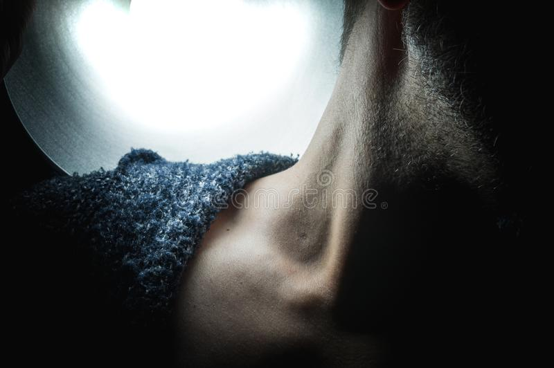 The neck of a man in the light stock photography