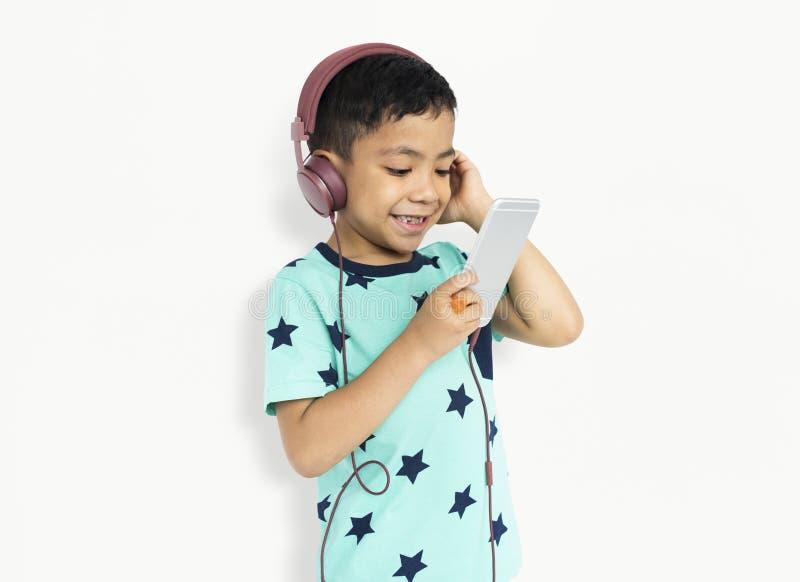 Studio Shoot People Portrait Concept. Studio Children Listening Music Portrait stock image