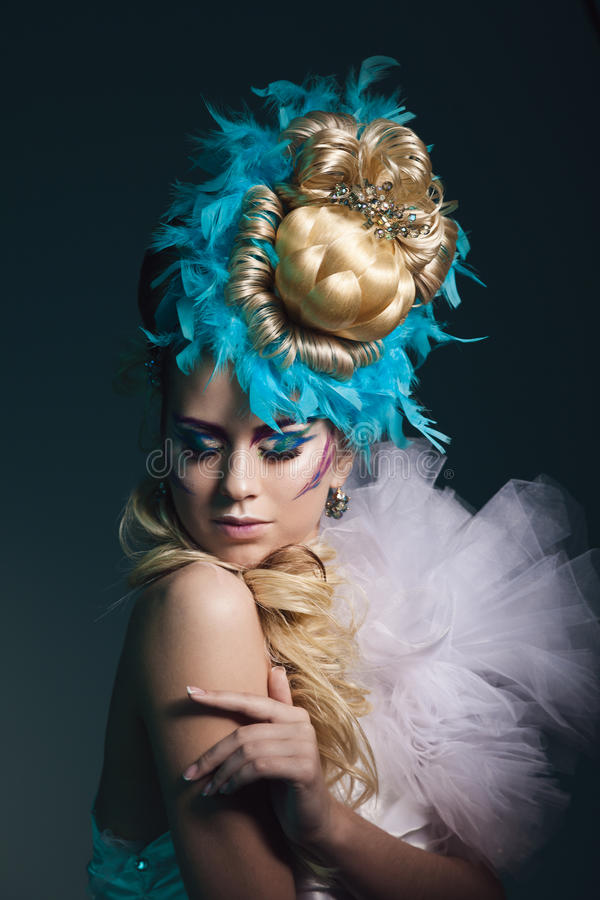 Studio shoot of woman with creative hairstyle, makeup and dress. royalty free stock images