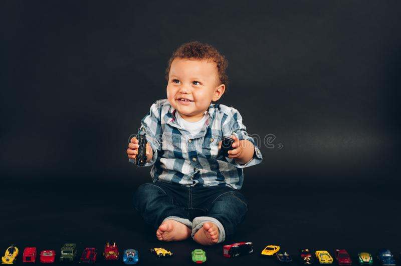 Studio shot of adorable african 9-12 month old baby boy stock image
