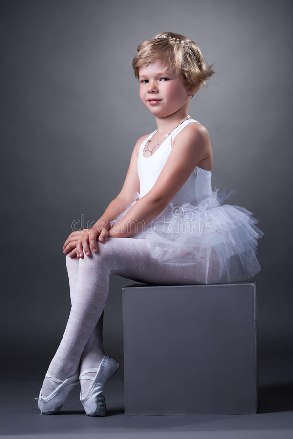 Studio shot of adorable girl posing in tutu royalty free stock photo