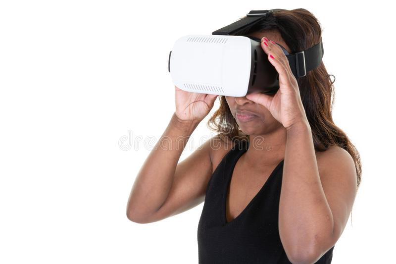 Studio shot of african american woman wearing virtual reality goggles watching movies playing video games. A Studio shot of african american woman wearing royalty free stock photos