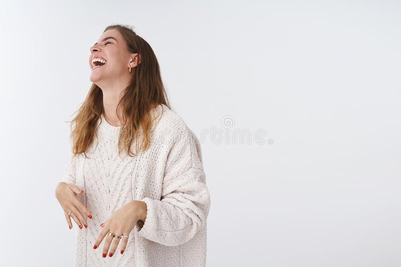 Studio shot amused happy attractive modern woman having fun laughing joking friendly company raising head chuckling lmao royalty free stock image