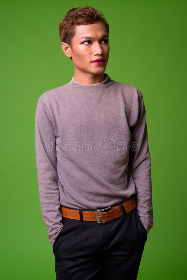 Androgynous young Asian man wearing makeup stock photos