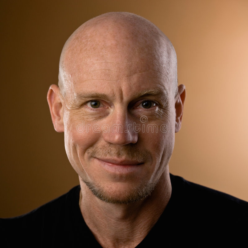 Studio shot of bald man with goatee and mustache stock photography