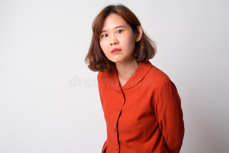 Portrait of angry Asian woman with short hair looking upset royalty free stock photos