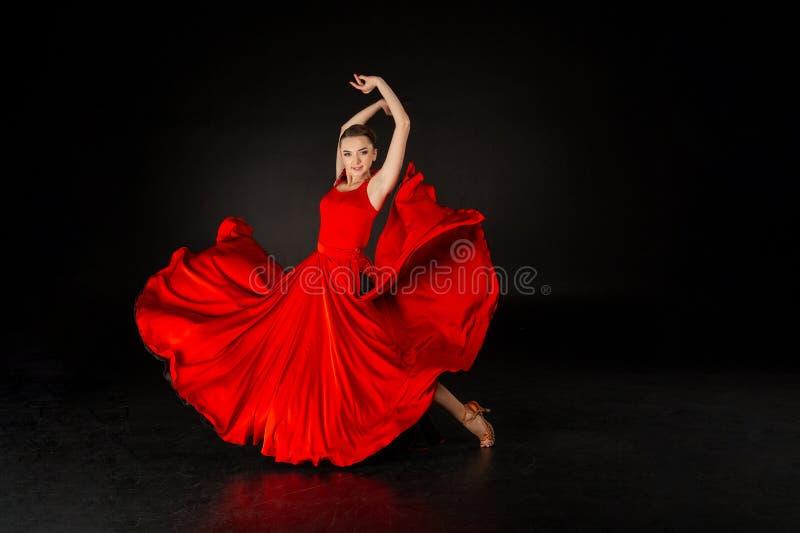 Studio shot of beautiful european girl in red dress stock images