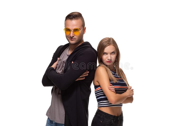 Studio shot of beautiful young couple standing back to back and looking at the camera stock photos