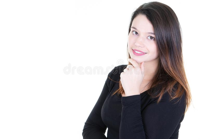 Studio shot of beautiful young woman with dark hair looking at camera with charming cute smile posing against white blank copy royalty free stock images