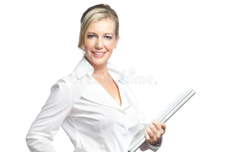Studio shot businesswoman holding laptop royalty free stock image