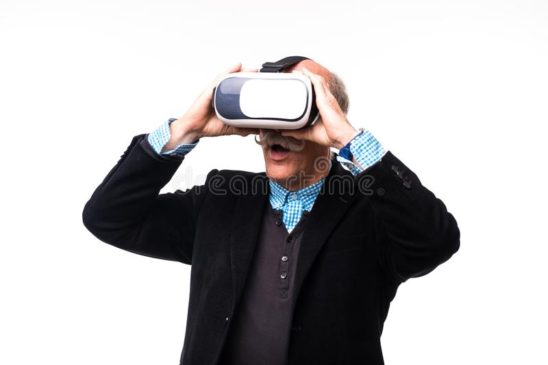 Studio shot of a cheerful senior using a VR headset isolated on white background royalty free stock photo