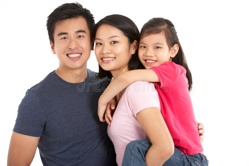 Studio Shot Of Chinese Family. Smiling To Camera royalty free stock photo