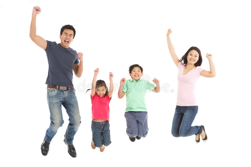 Studio Shot Of Chinese Family Jumping In Air Royalty Free Stock Photography