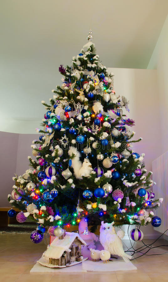 Studio shot of a Christmas tree with colorful decorations royalty free stock photo