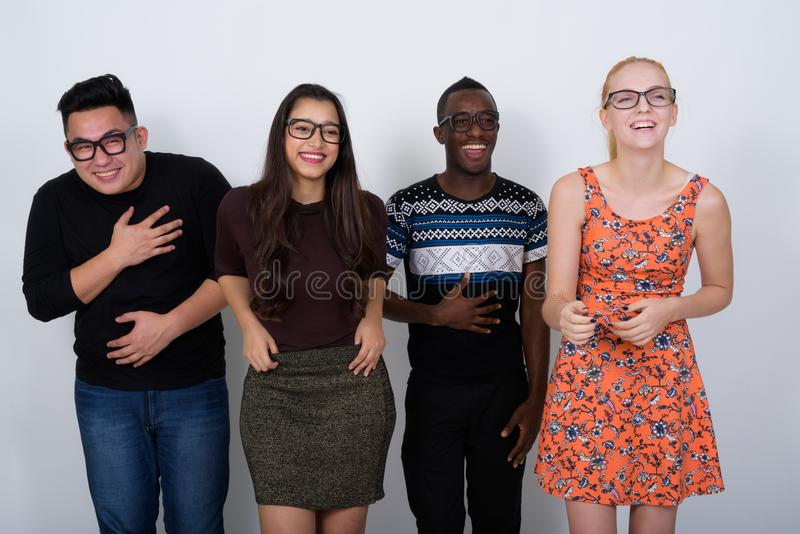 Studio shot of diverse group of multi ethnic friends laughing wi stock image