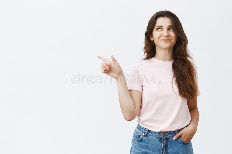 Studio shot of excited and pleased happy woman holding laughing inside and grinning from joy and fun looking and stock photos