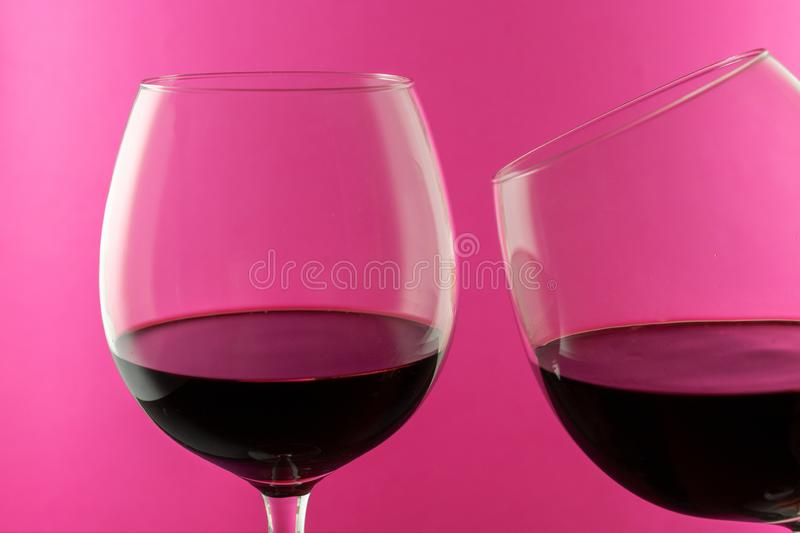 Rose wine in wine glasses isolated on pink background. Use for restaurant cafe. Wine concept. stock images