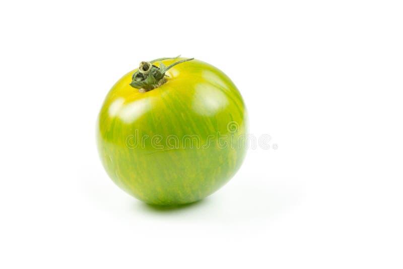 Studio shot of green tomato royalty free stock images