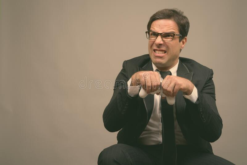 Portrait of handsome Persian businessman in suit royalty free stock photography