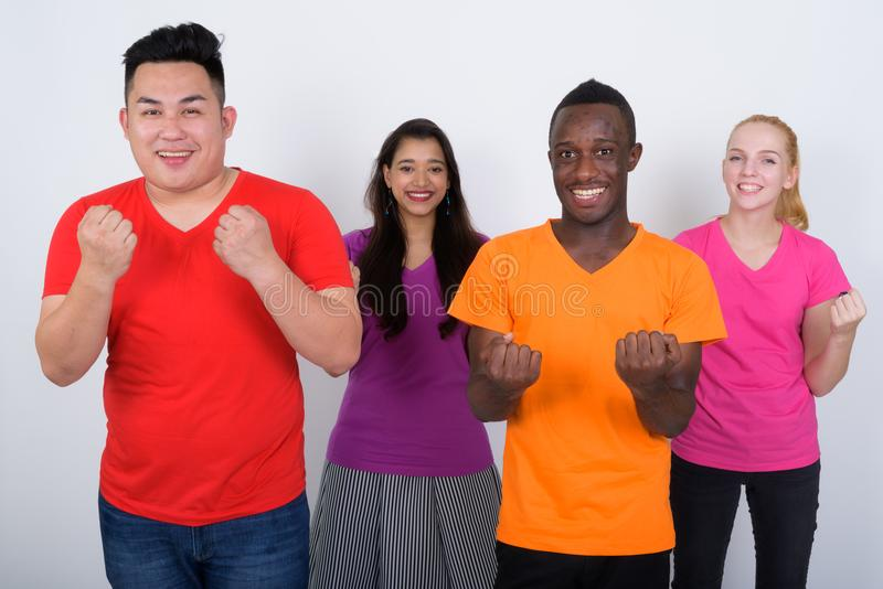 Studio shot of happy diverse group of multi ethnic friends smili stock images