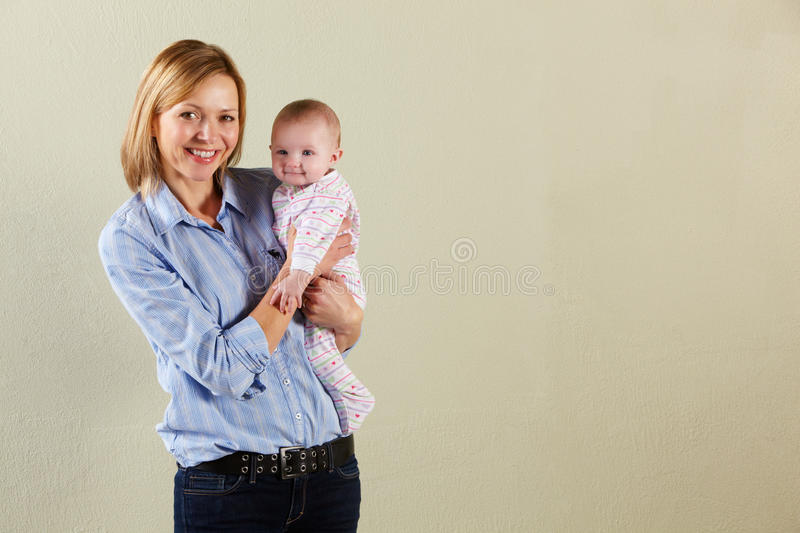 Download Studio Shot Of Happy Mother And Baby Stock Image - Image of casual, mother: 23959975
