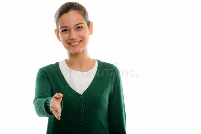 Studio shot of happy young beautiful woman smiling while giving. Studio portrait of beautiful woman isolated against white background stock images