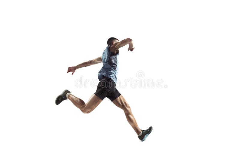 The studio shot of high jump athlete is in action. Isolated on white background royalty free stock photo