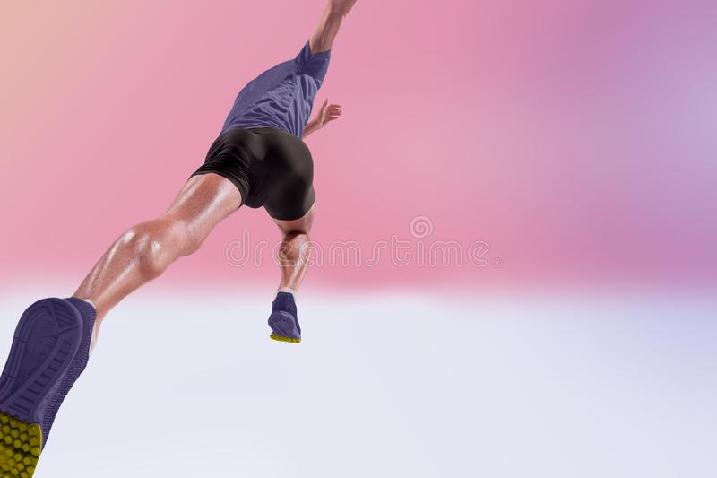 The studio shot of high jump athlete is in action. On pink background royalty free stock photography