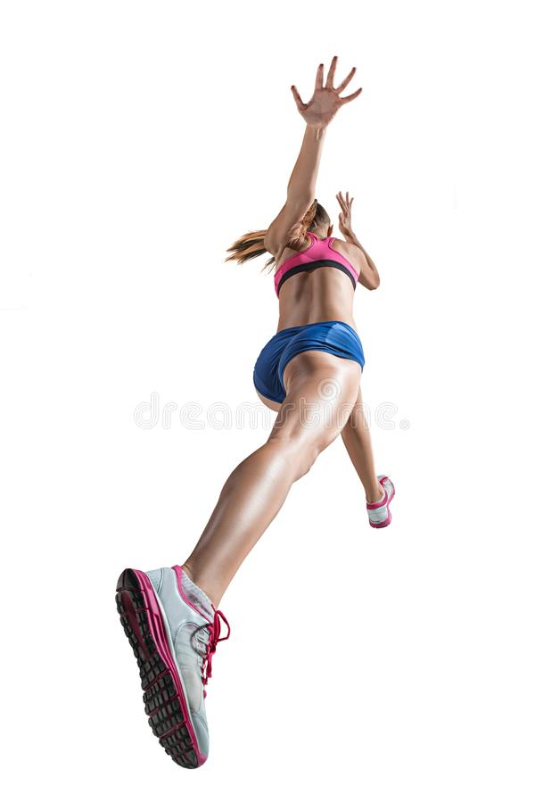 The studio shot of high jump female athlete is in action. The studio shot of high jump athlete or fit woman in action isolated on white background royalty free stock image