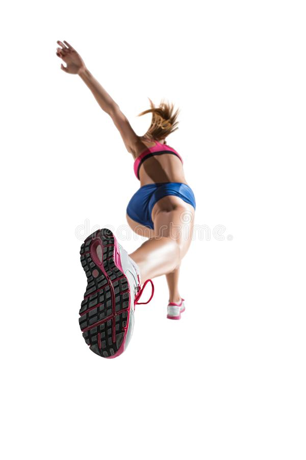 The studio shot of high jump female athlete is in action. The studio shot of high jump athlete or fit woman in action isolated on white background stock photos