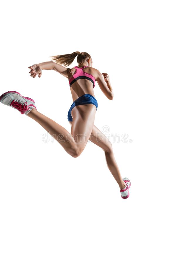 The studio shot of high jump female athlete is in action. The studio shot of high jump athlete or fit woman in action isolated on white background stock photo