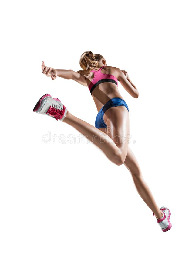 The studio shot of high jump female athlete is in action. The studio shot of high jump athlete or fit woman in action isolated on white background stock image
