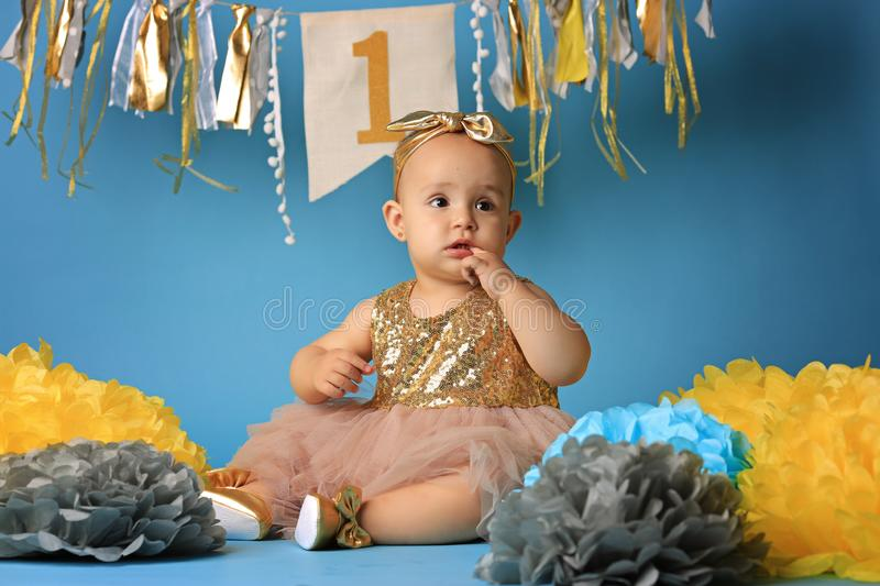 Studio shot, little girl on blue background in beautiful festive dress royalty free stock images