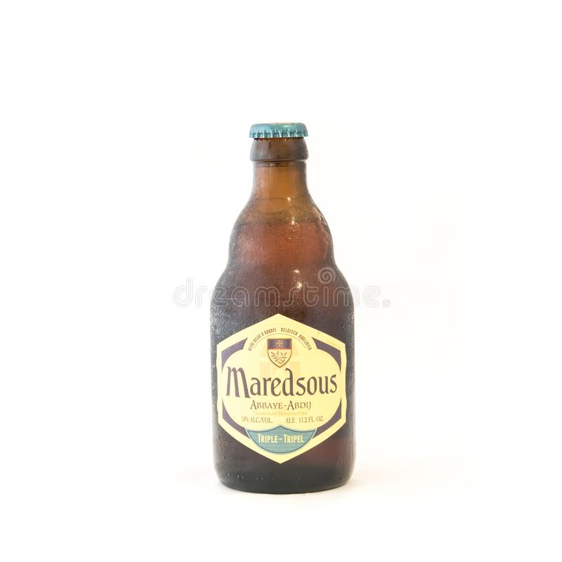 Studio shot Maredsous Triple Belgium beer isolated on white stock photography