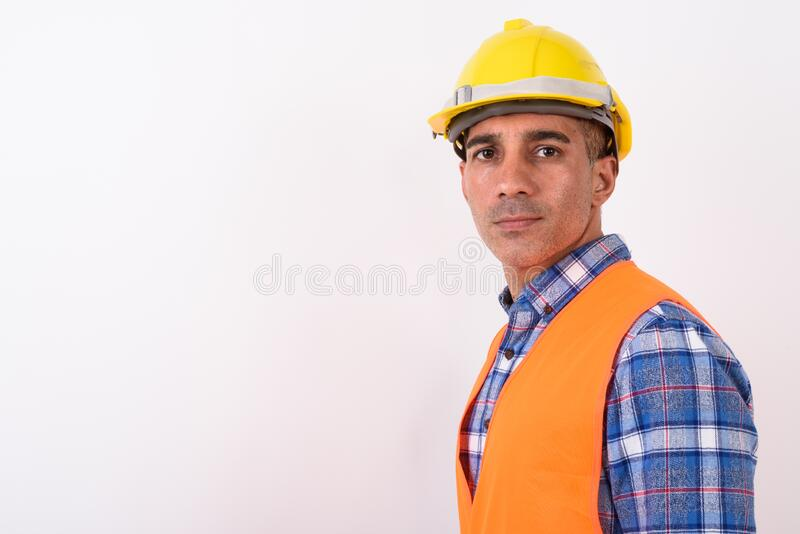 Portrait of mature Persian man construction worker. Studio shot of mature Persian man construction worker against white background stock images