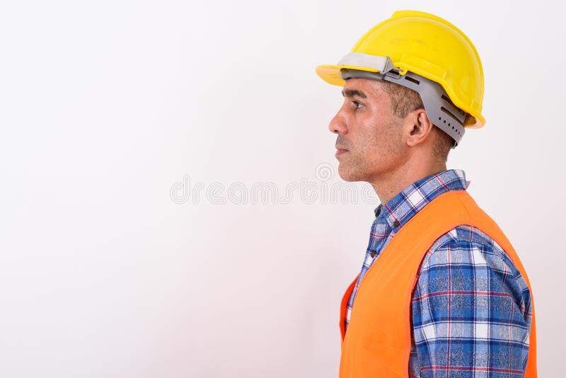 Portrait of mature Persian man construction worker. Studio shot of mature Persian man construction worker against white background stock photography