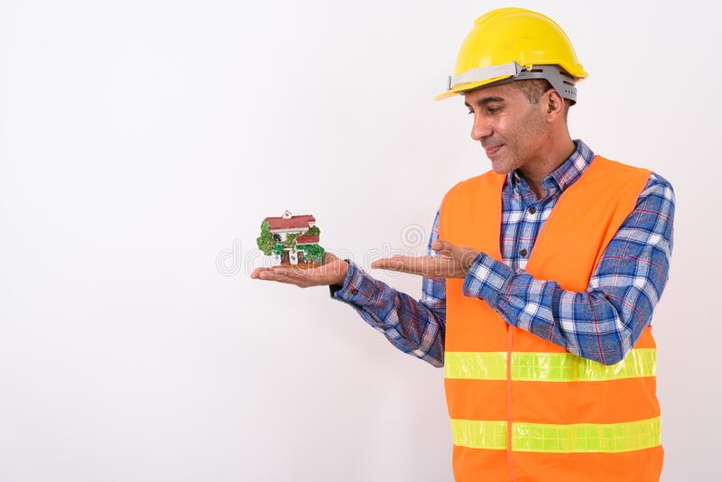 Portrait of mature Persian man construction worker royalty free stock photo